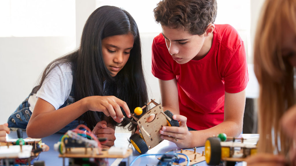 kids learning science education by building a robot car kit